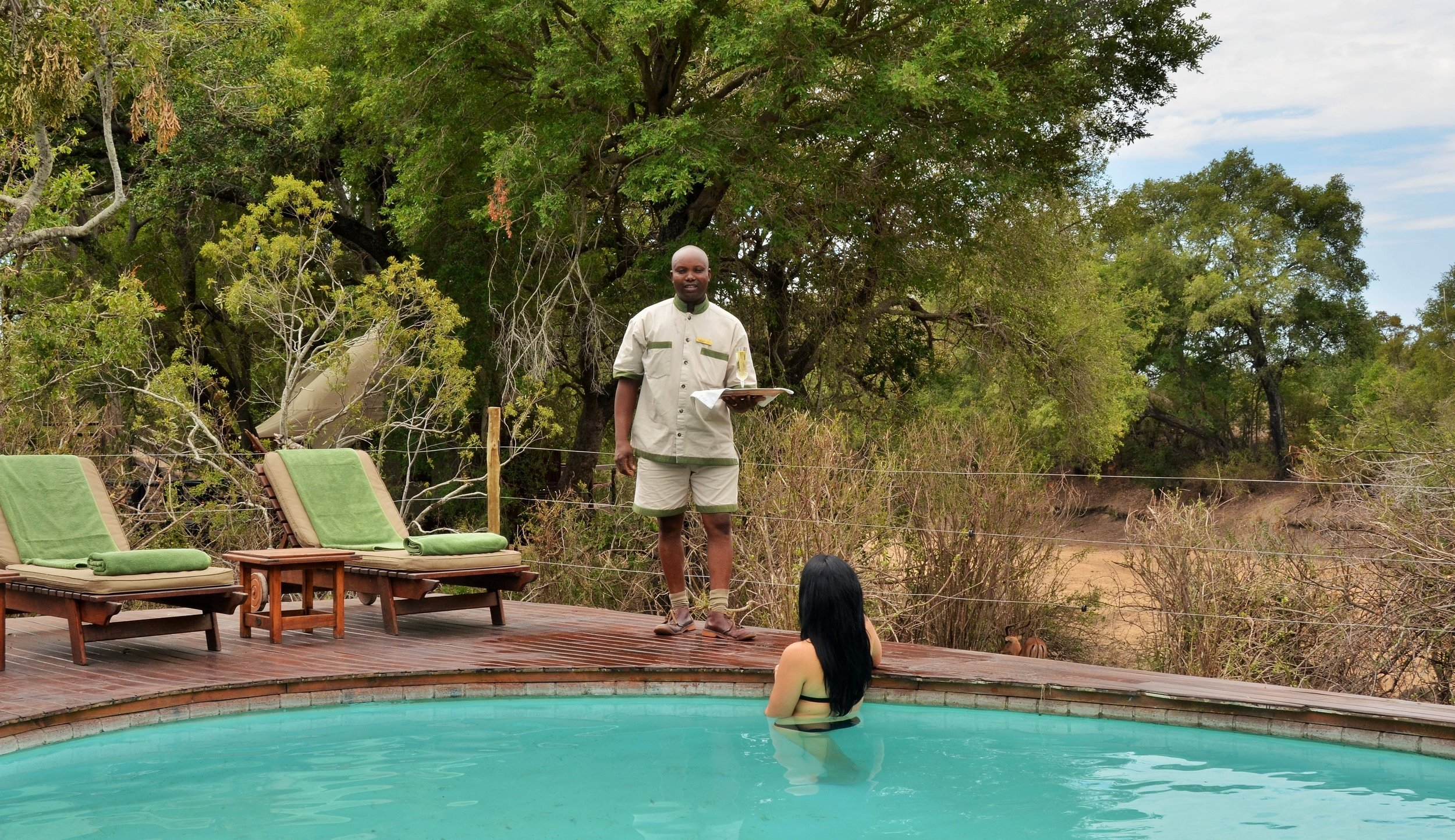 hamiltons_tented_camp_-_drinks_at_the_pool.jpg