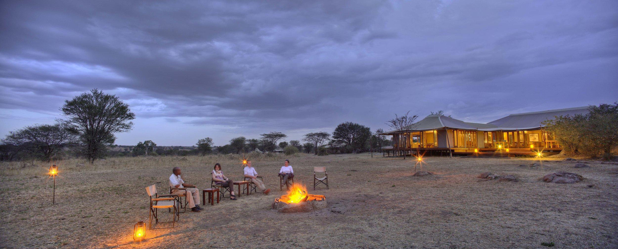 Sayari-drinks-by-the-campfire.jpg