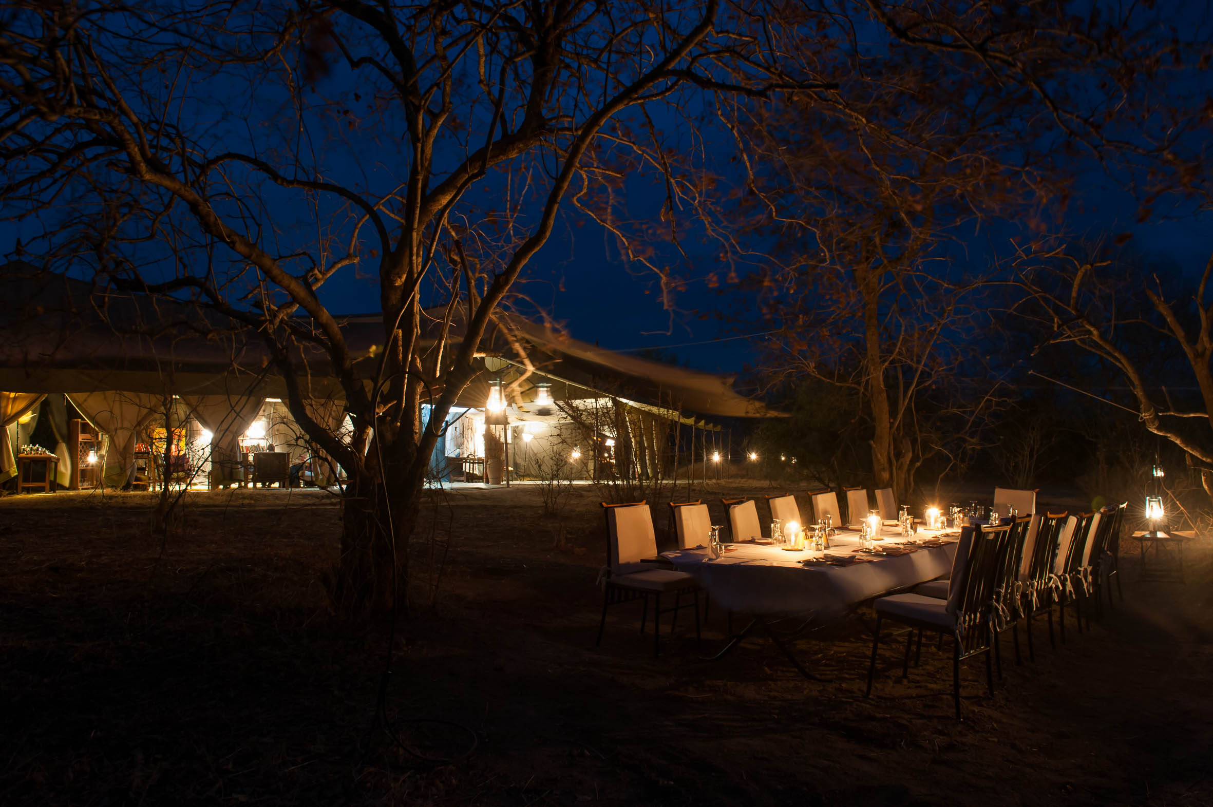 Kwihala-Camp-Mess-Area-Dining-At-Night-Paul-Joynson-Hicks-LR.jpg