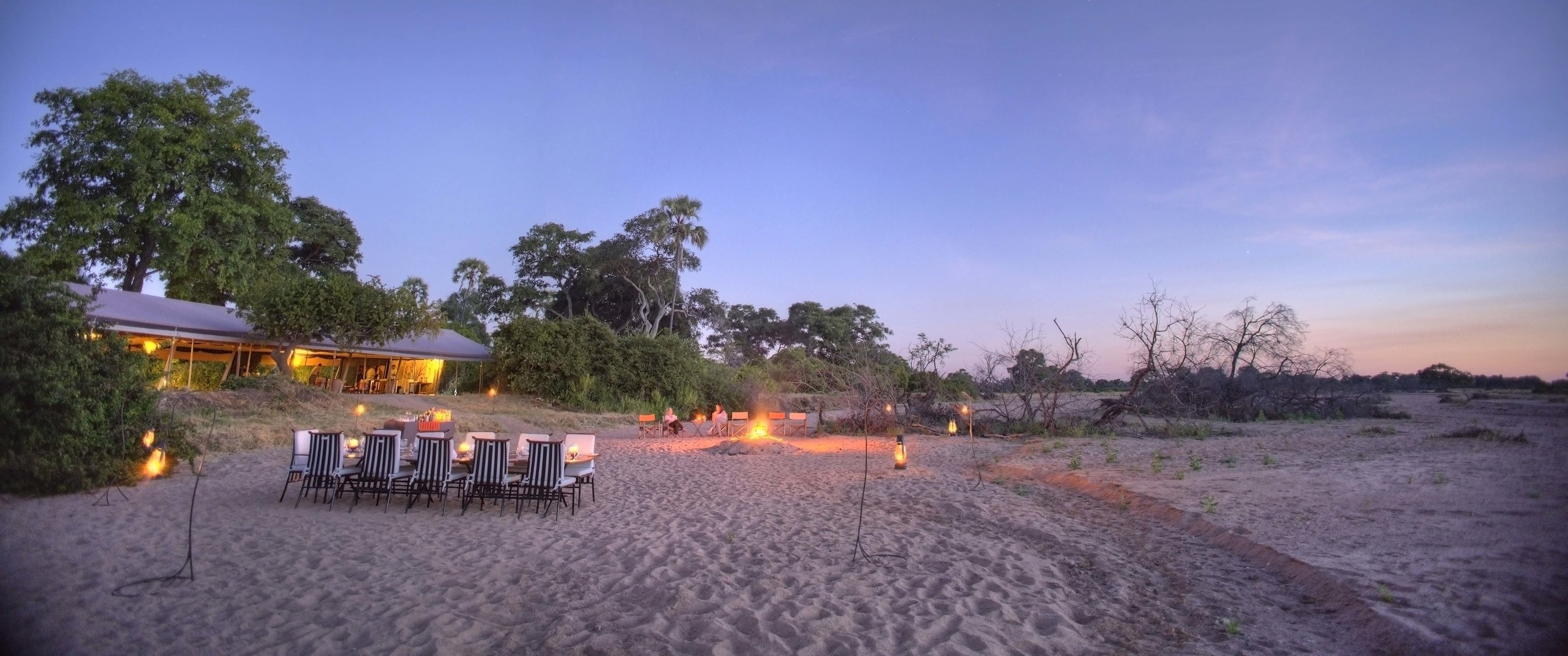 Kwihala-sundowners-and-dinner-set-up-around-fire.jpg