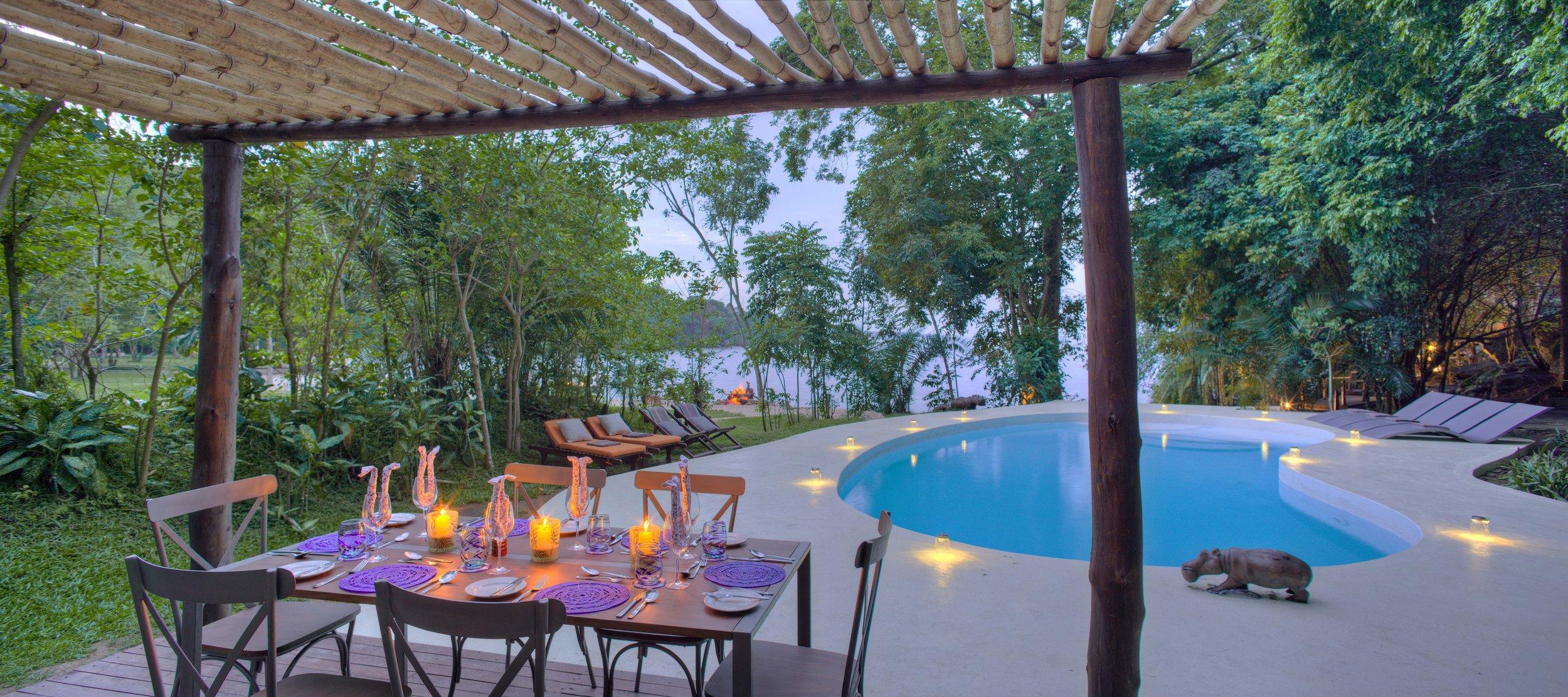 Rubondo-Island-Private-dining-set-up-around-the-pool-overlooking-Lake-Victoria.jpg