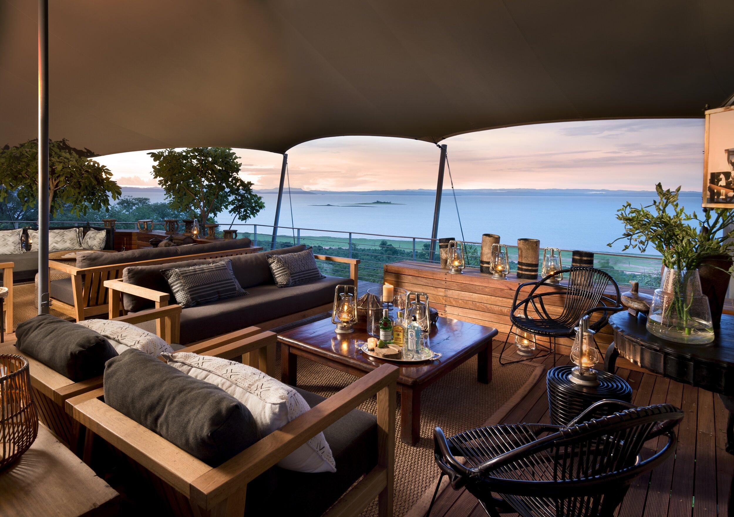 bumi_hills_safari_lodge_lake_kariba_zimbabwe_luxury_safari_lodge__kingfisher_cottage_double_suite_living_room_lake_view_african_bush_camps_32.jpg