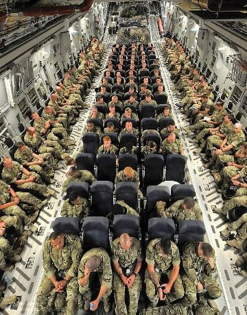 Soldiers going to war in a plane
