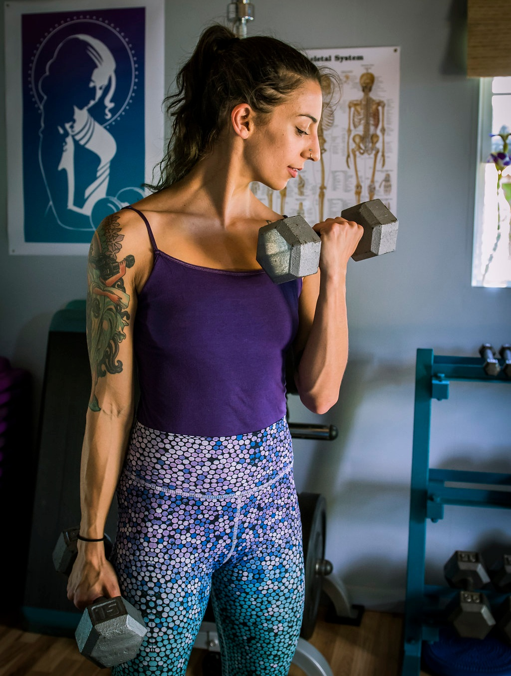Personal trainer Taija Ventrella working out in her private fitness studio in West Asheville.
