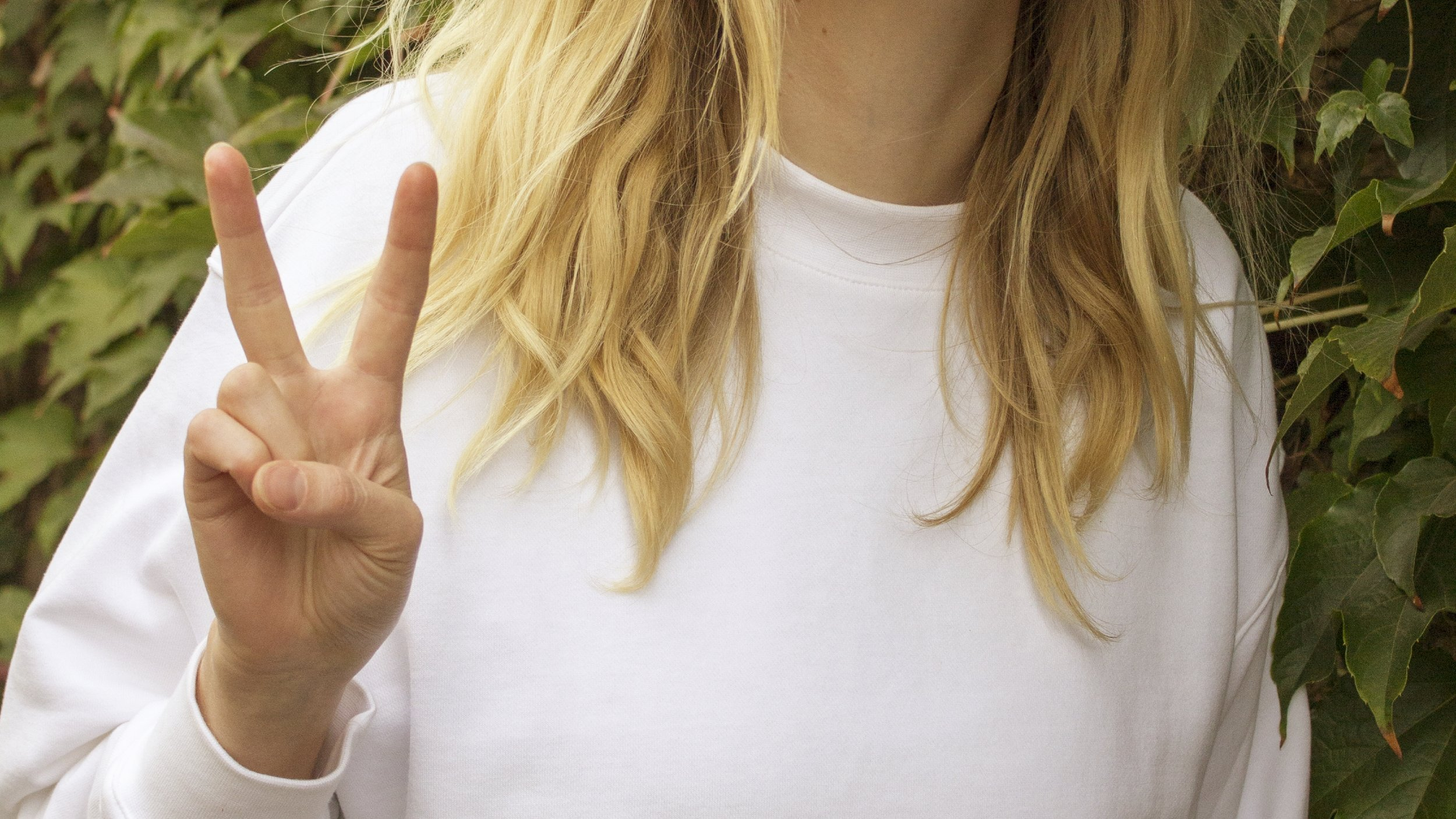Romana doing peace hand sign