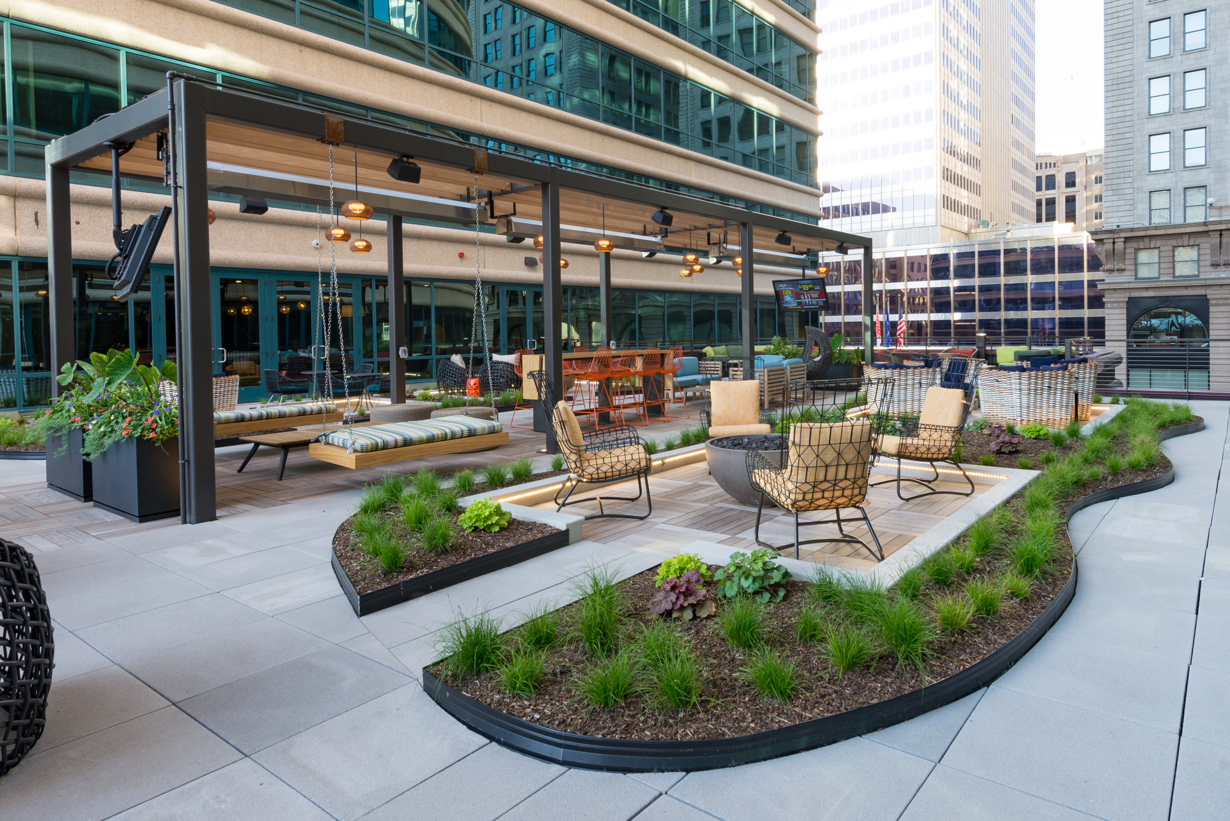 Fifth Street Towers, Minneapolis MN. Downtown work environments require amenity decks that complement hardscape and furnishings with vibrant floral and green interest. Our designers enjoy getting clients involved in the collaborative creative process.