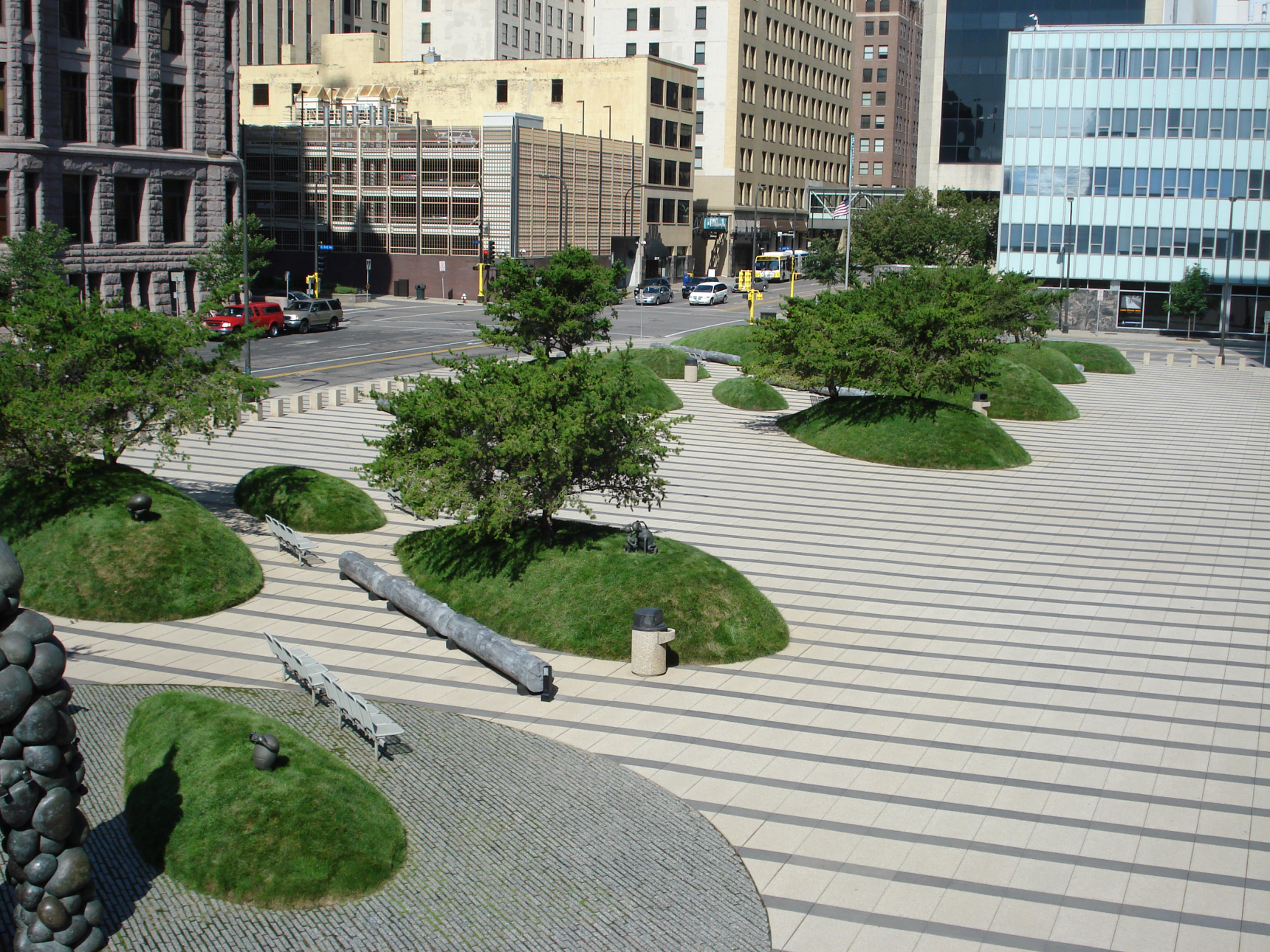 Federal Courthouse Minneapolis MN. Designed by Martha Schwartz Partners, these turf mounds represent drumlin deposits left by glaciers but are actually a clever security feature protecting the buildings while providing artistic and environmental interest. This iconic property is an urban treasure that our team proudly maintains.