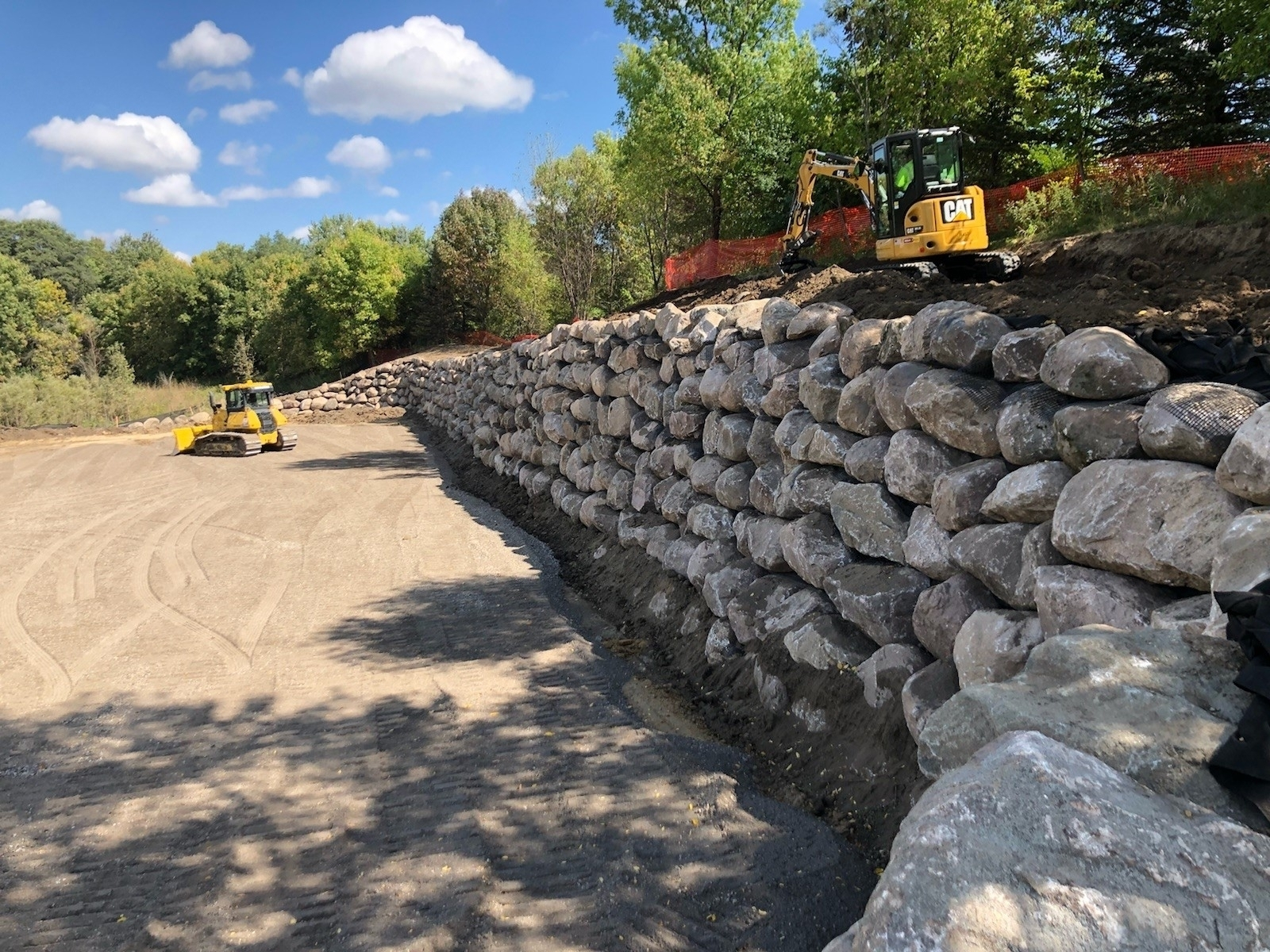 Boulder wall installations require expertise and specialized equipment. Bloomington, MN