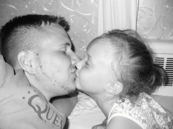 Kyla, with her dad, during childhood