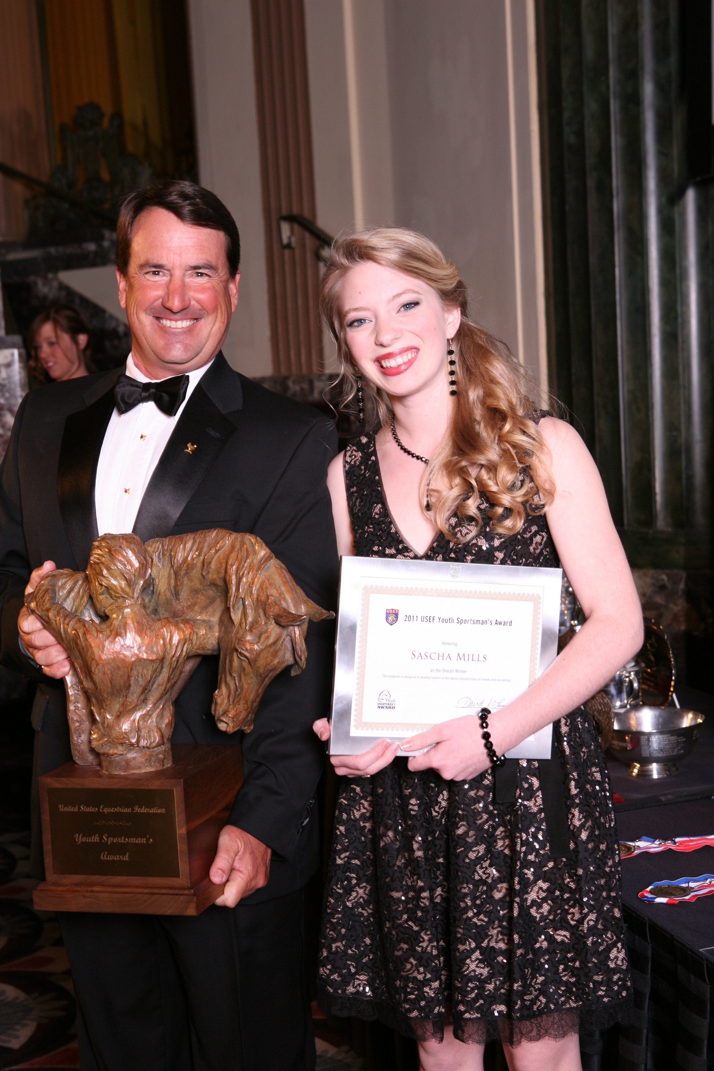 Sascha Mills receives the 2011 USEF Youth Sportsman's Award from USEF President David O'Connor. Photo courtesy USEF Archive/Geoff Bugbee.