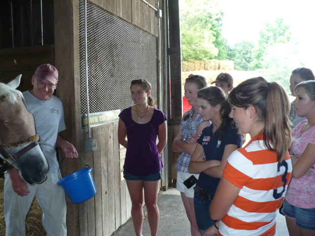 USEF Youth Career Workshop attendees take an educational tour of the Old Friends Retirement Farm. Photo courtesy USEF staff.