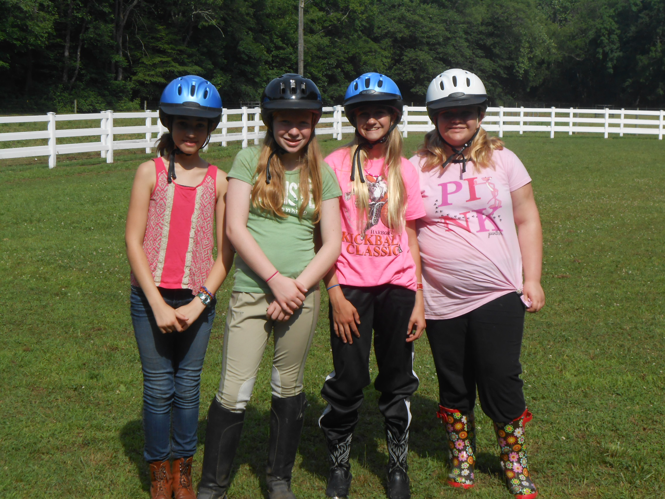 Girl Scout Juniors prepare for equestrian activities at Camp Skymeadow outside Pittsburgh. Photo by Lisa Shade, Girl Scouts Western Pennsylvania.