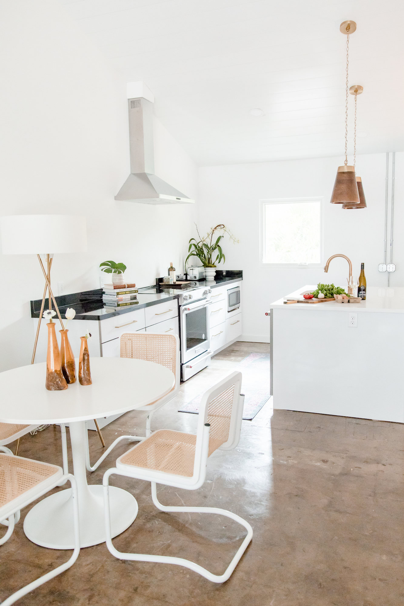 mid-century-modern-kitchen-vacation-rental-the-park-white-wicker-chairs-web-resolution.jpg