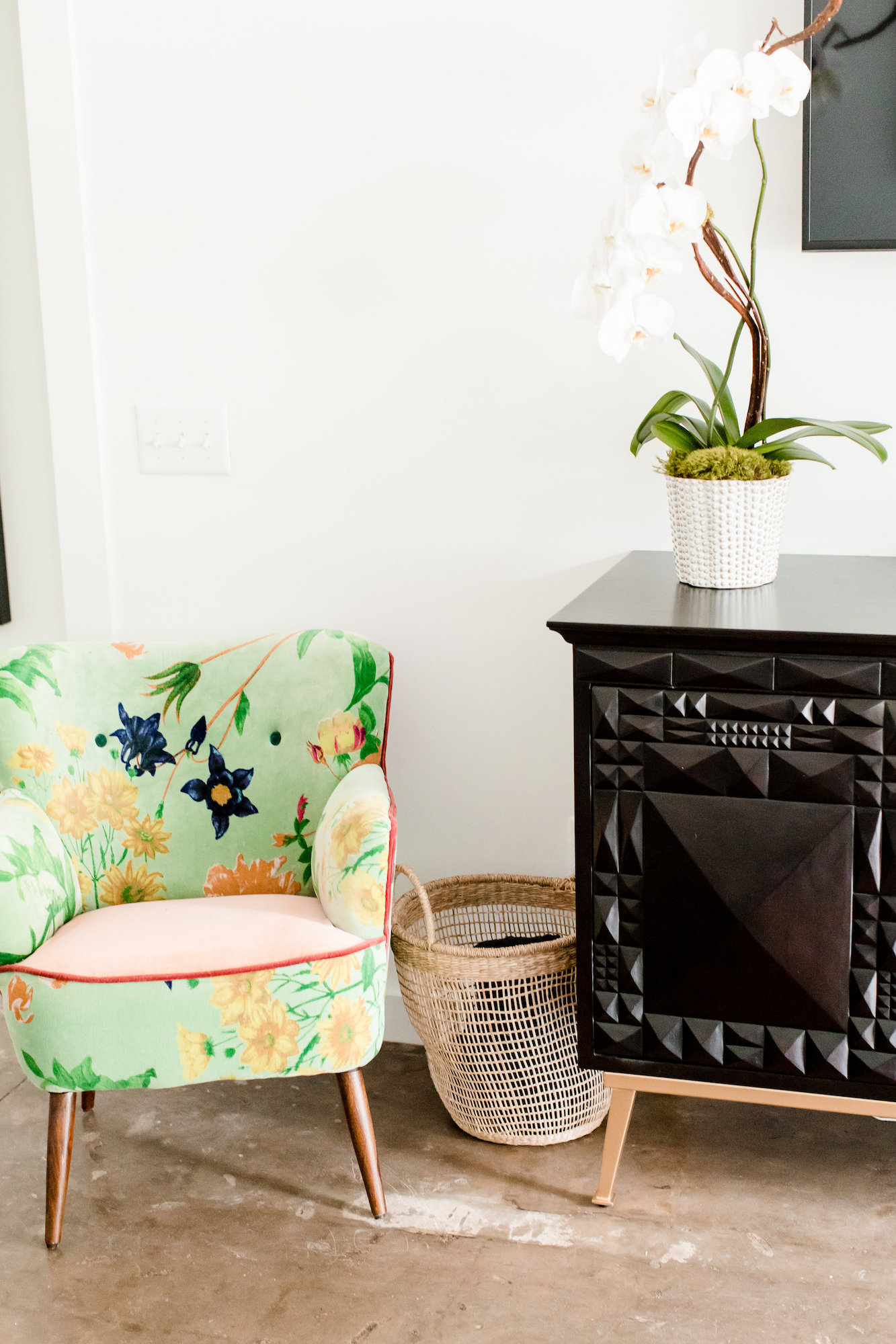 mid-century-modern-vacation-rental-green-chair-black-cabinet-plant-web-res.jpg