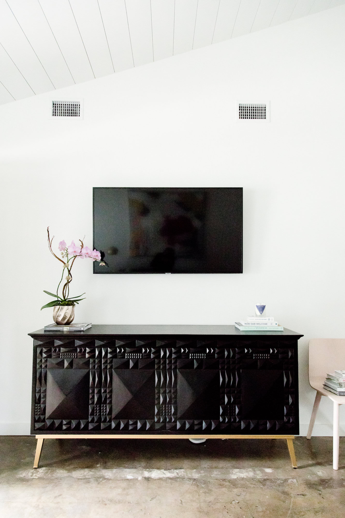 mid-century-modern-rental-black-cabinet-tv-web-resolution.jpg