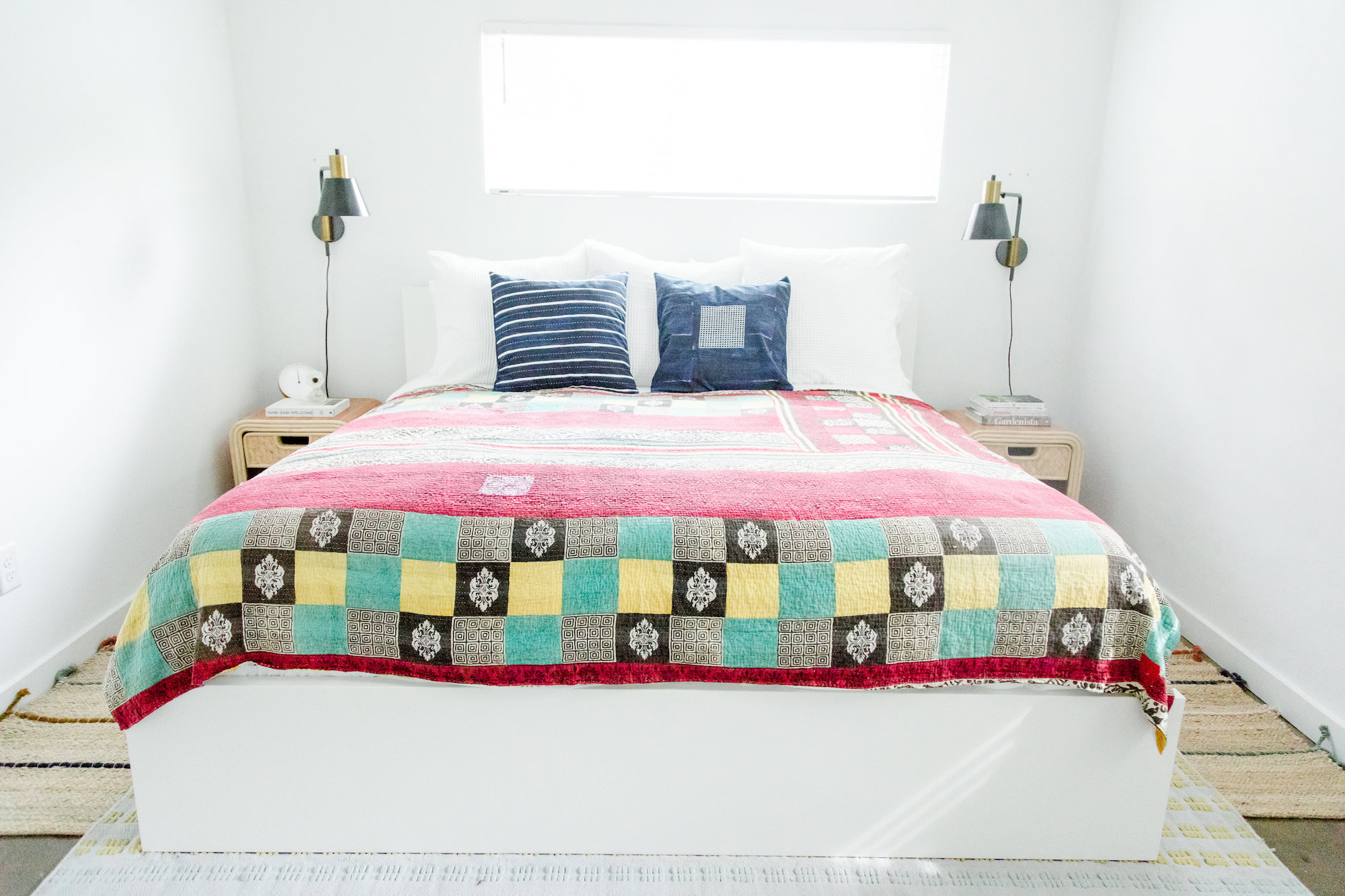 modern-bedroom-white-colorful-quilt-web-res.jpg