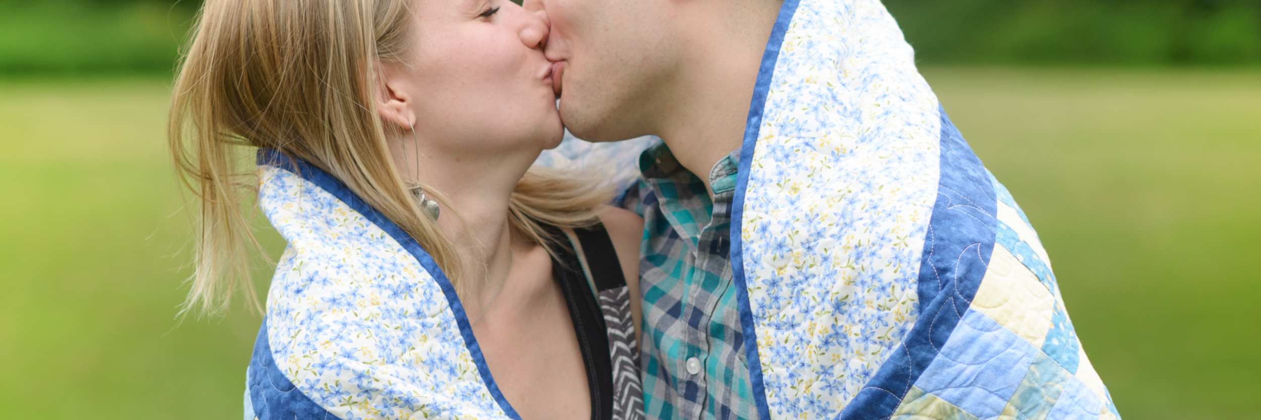 cropped couple kissing w quilt copy.png