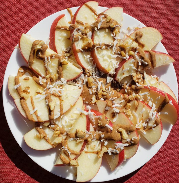 Apple Nachos with coconut, walnuts, and almond butter