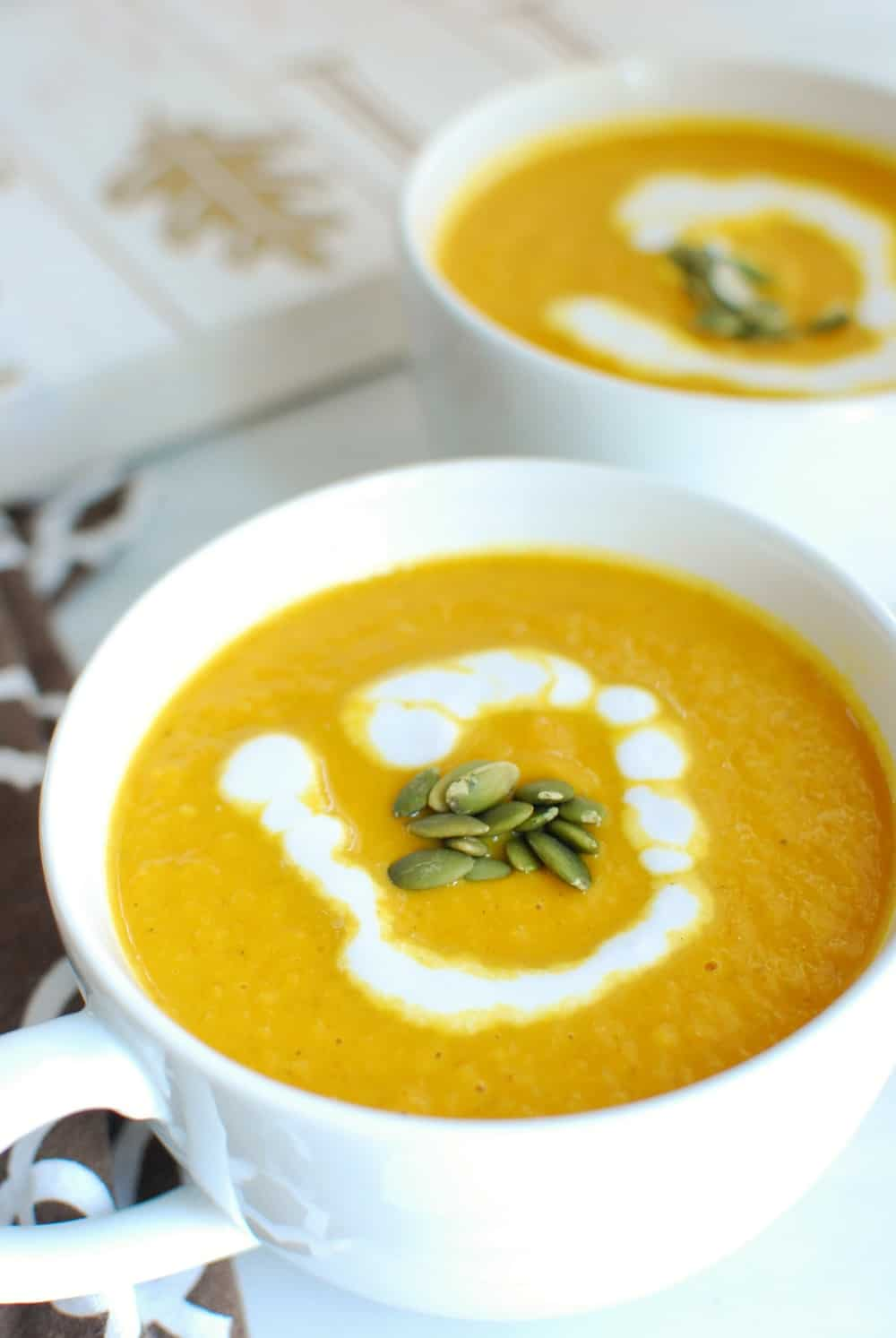 "Vegan Pumpkin Soup - This recipe creates the ""perfect blend of sweetness from the pumpkin and apple, savory elements from the onion and broth, and richness from the coconut milk! Plus, from start to finish, this soup is ready in under 30 minutes.""by Dairy Free For BabyFind the recipe here"