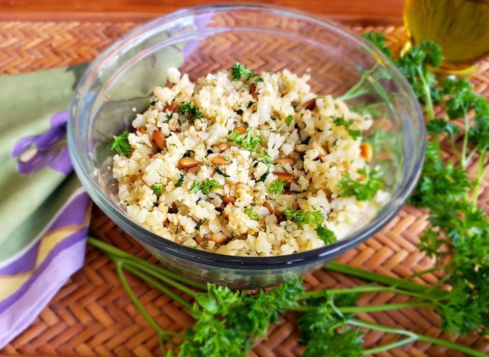 Cauliflower rice pilaf with toasted pine nuts.