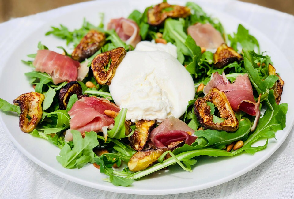 Burrata, prosciutto, and fig salad.