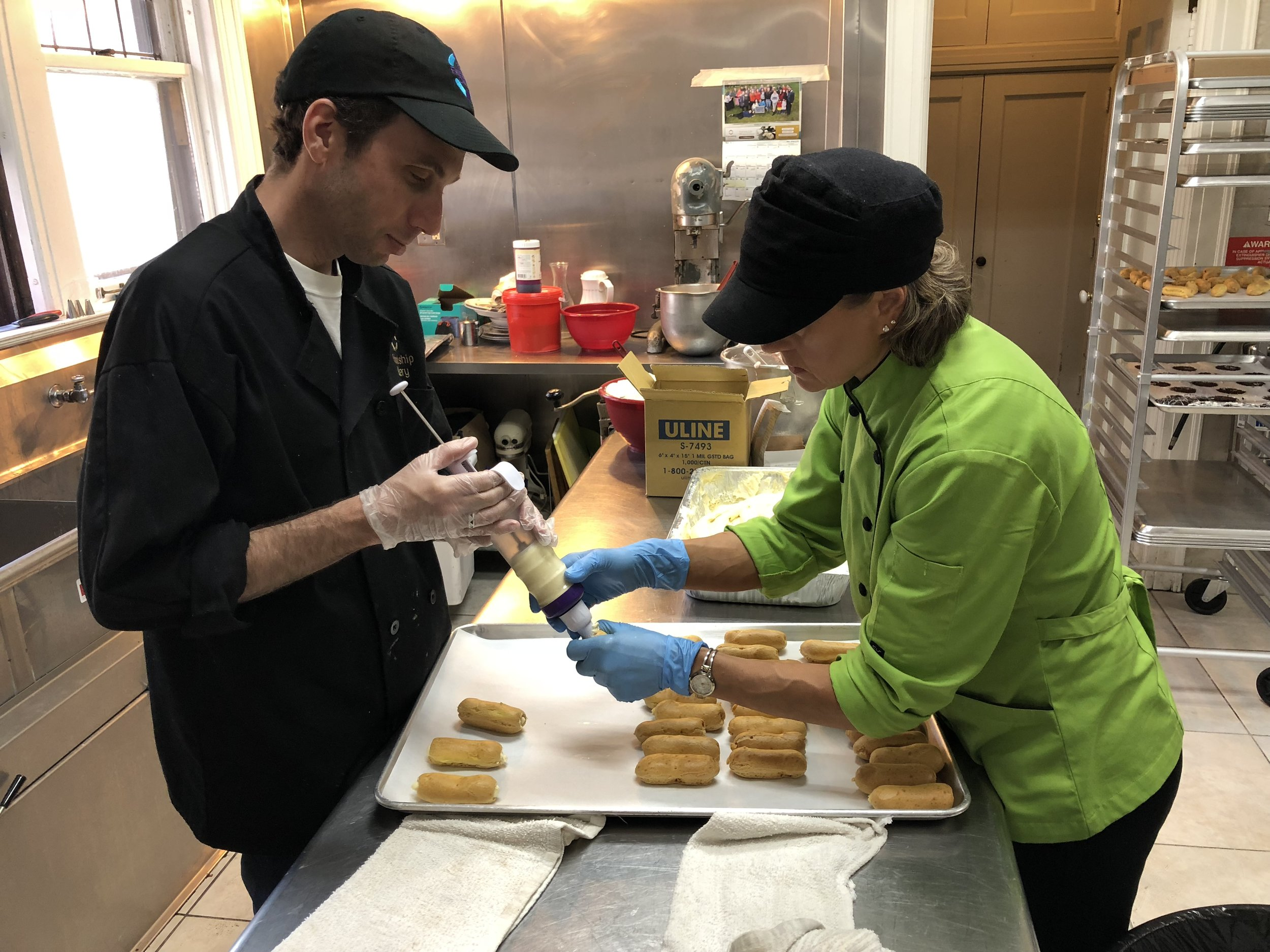 Filling Eclairs with the help of Chef Dina