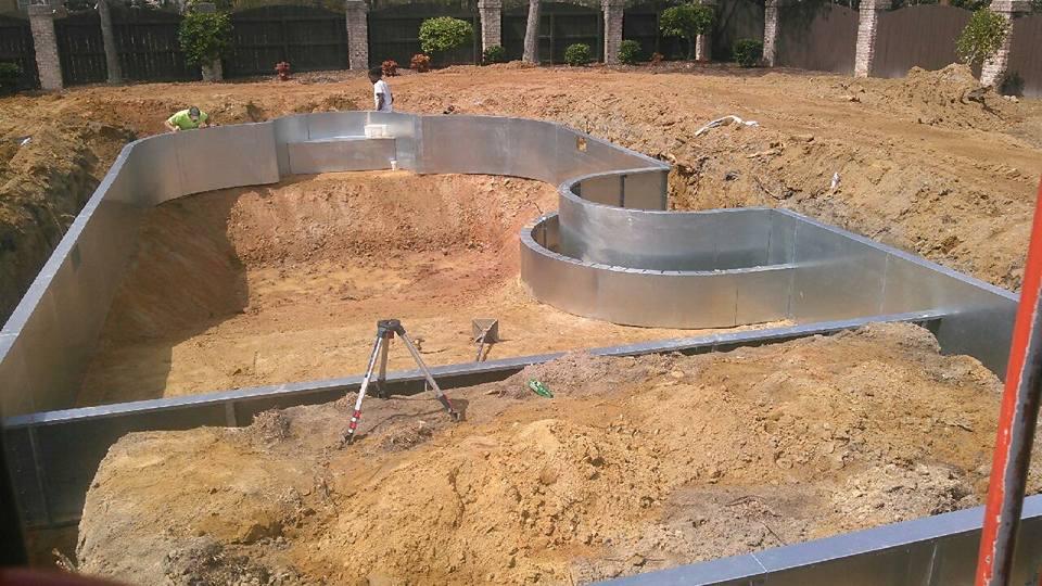 The installation of a steel pool in progress.