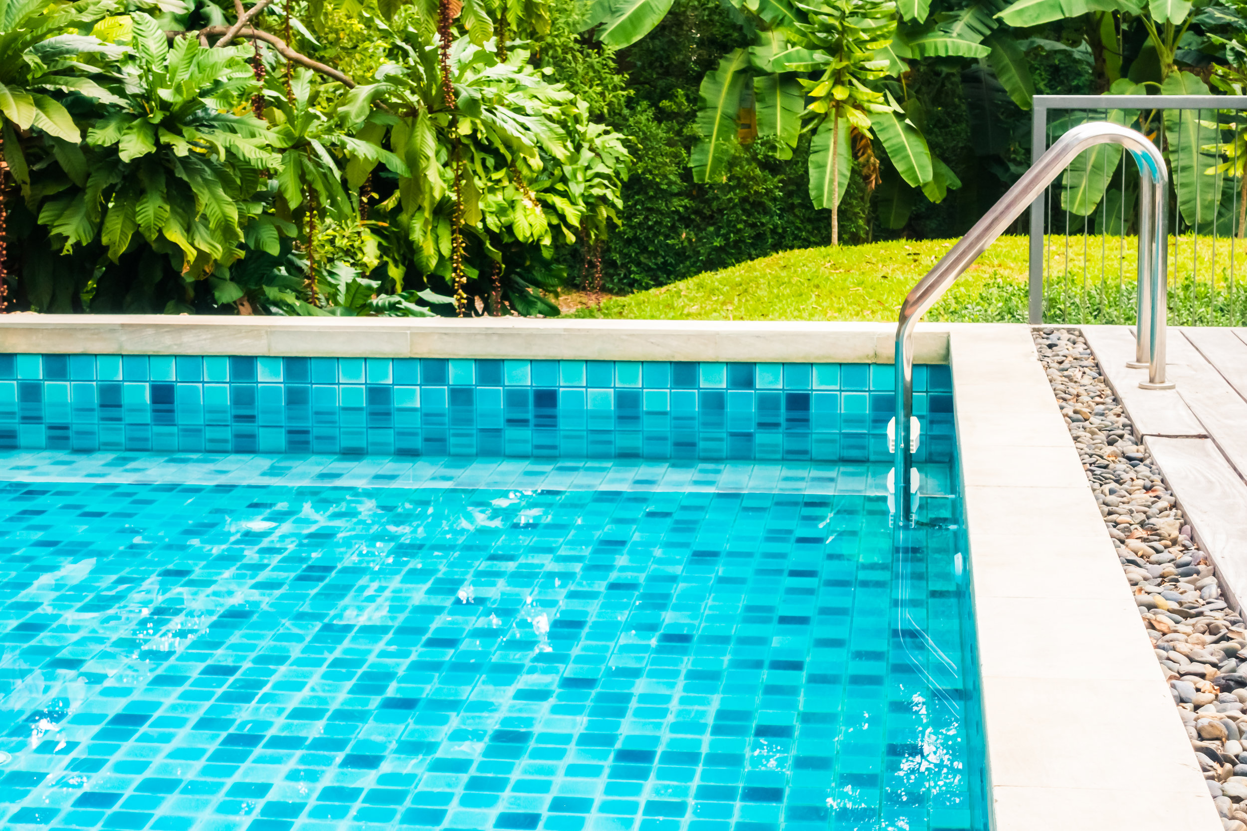 A pool liner with the sparkle of blue glass tiles.