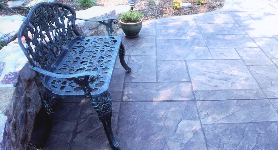 Concrete stamped, colored, and finished to look like natural slate tile.