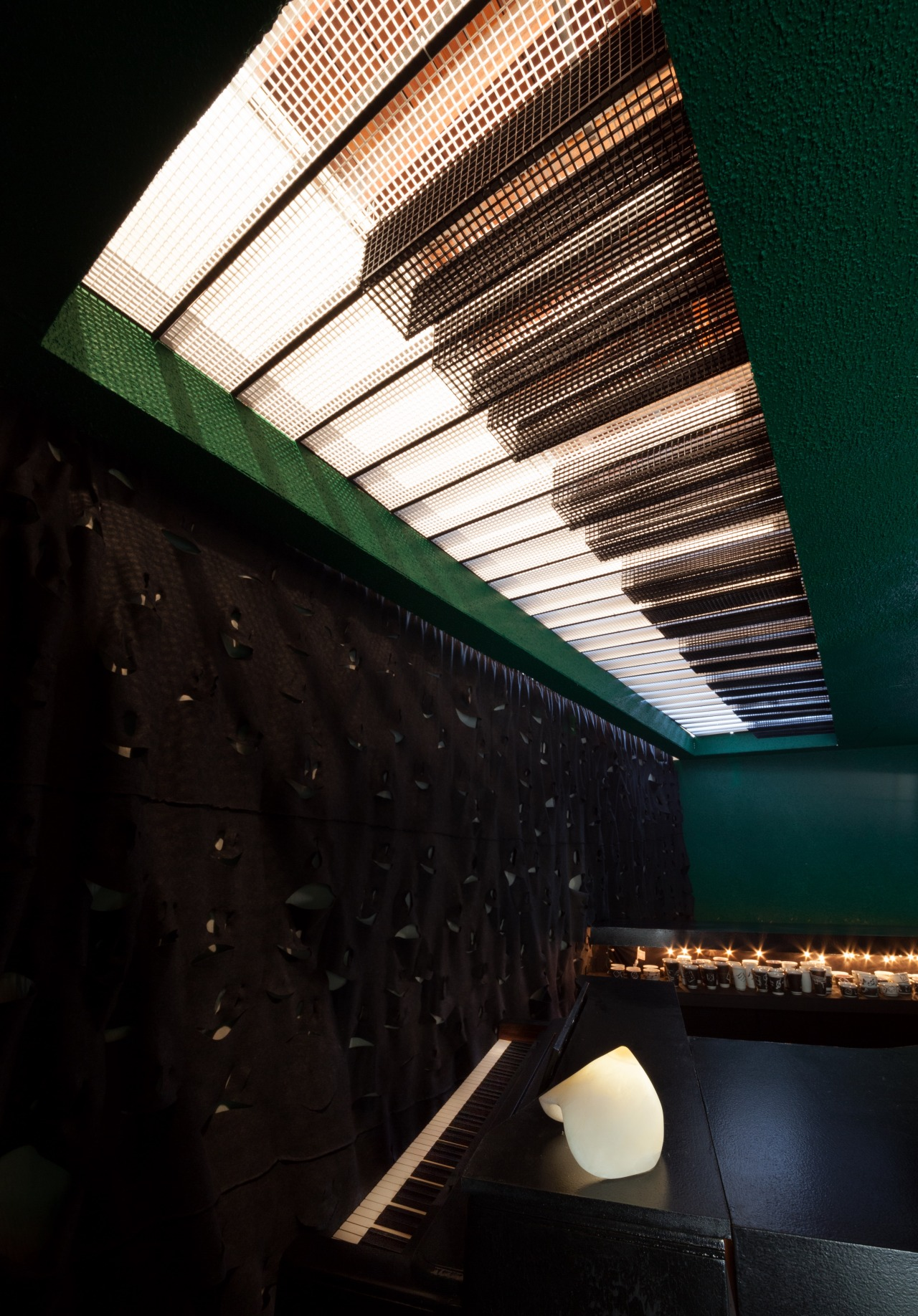 Designer/Artist Joakim Dahlqvist designed the accompanying piano light fixture while Artist Grant Levy Lucero designed and produced the dramatic backdrop of the bar. The Boob Light is the work of artist Nevine Mahmoud.