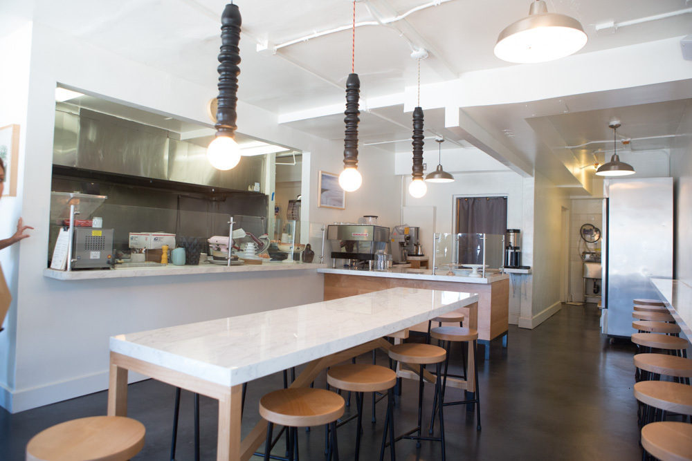 Project Room designed the wood turned lighting fixtures as well as designed and produced the communal marble table.