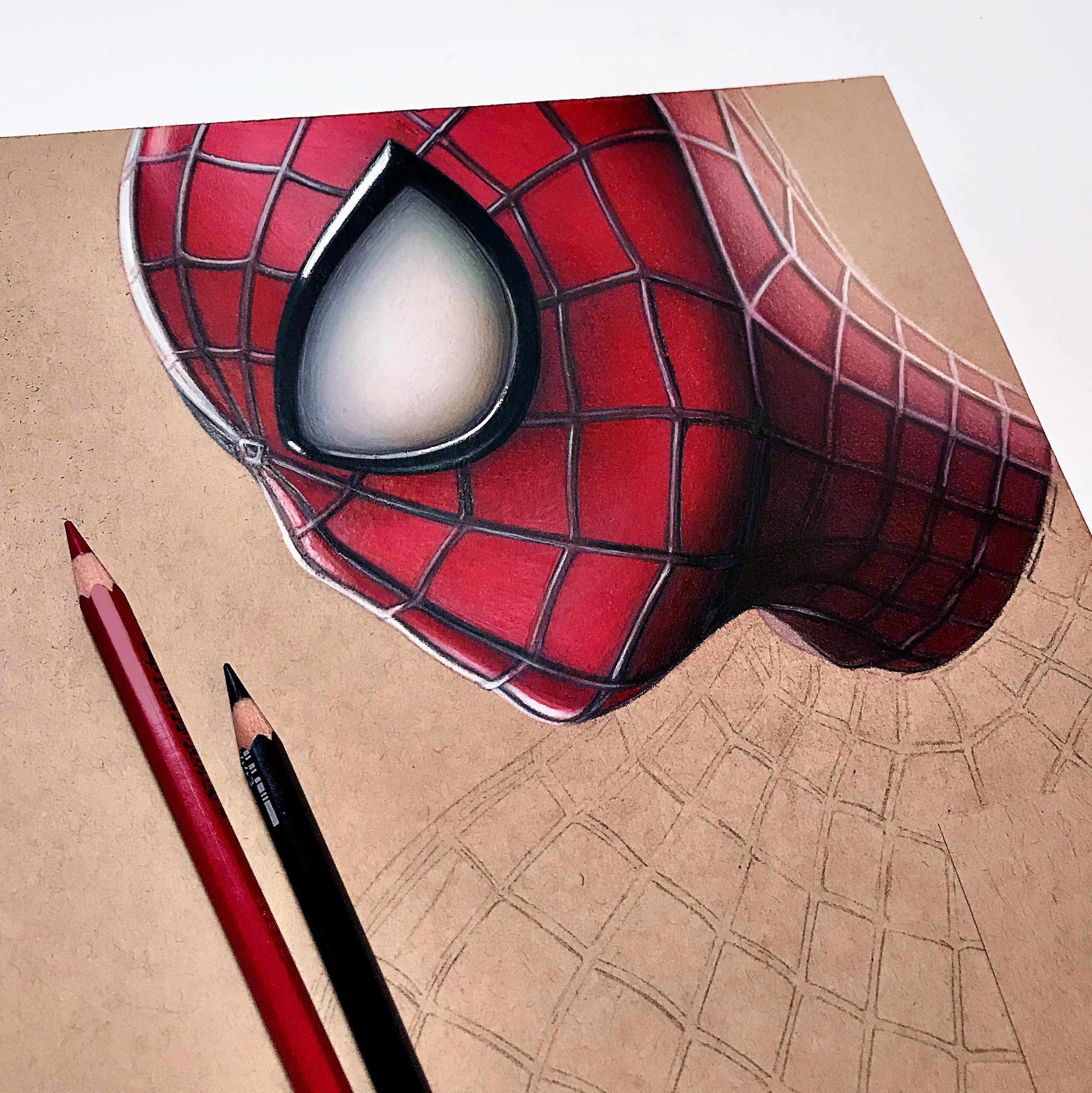 Next… - I started to add color to the portrait by starting with a base layer of red and then build up those shades of red by adding layers. When referencing my black/white version, I would add darker shades of red, brown, and black over top of areas that had deeper shadows to really add depth and give my drawing the Spidey look! For a more in depth look of how I completed this drawing from start to finish, check out the full video time lapse down below.