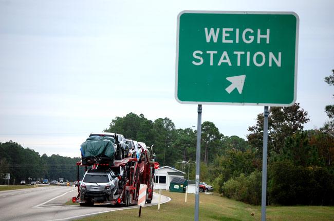truck-entering-weigh-station-example-Millennials in Trucking