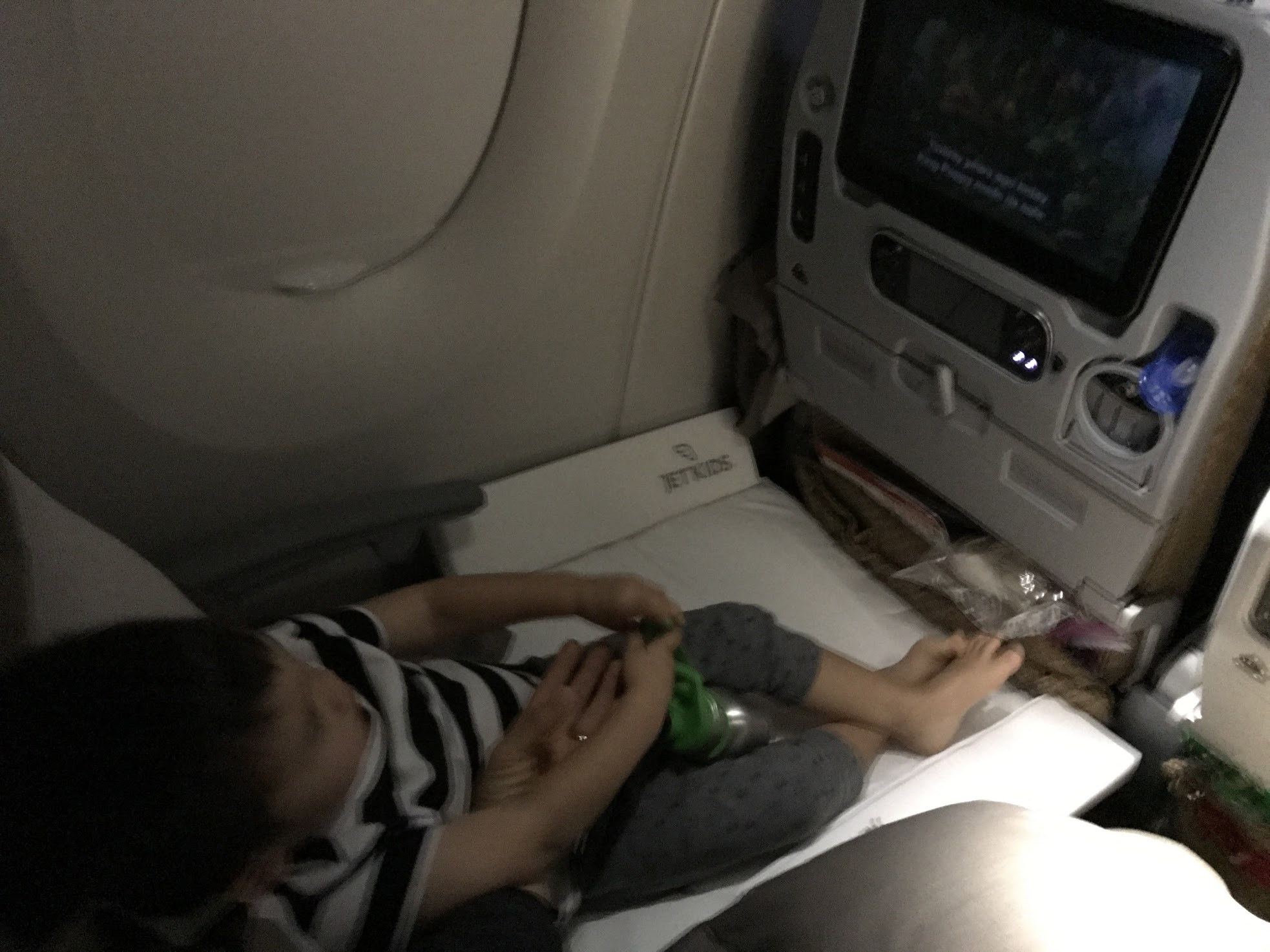 """The Stokke JetKids Bed Box - We got this once my daughter was old enough to wheel herself around. It meant we moved quicker around the terminal and it converted to a """"poor man business class� for our 2yo in economy class. Brilliant design! It's $199 on Amazon, not cheap, but considering we do this flight often, it was a great business class upgrade."""