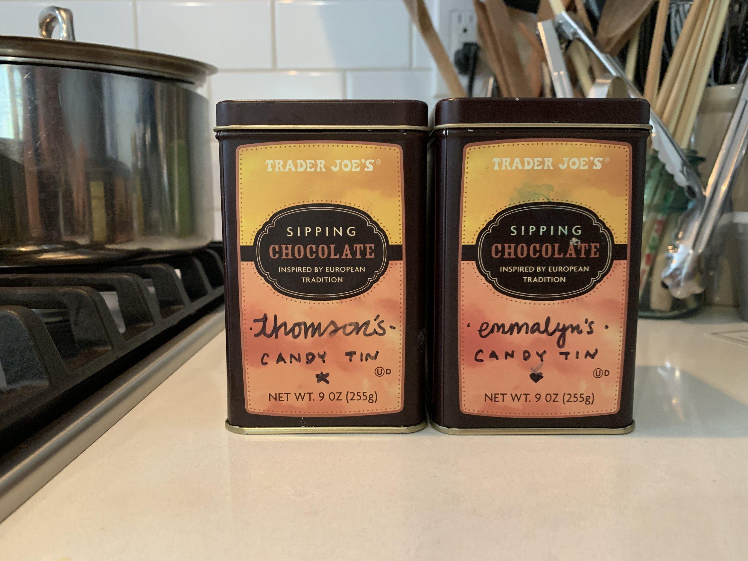 Recycled Trader Joe's hot cocoa powder tins for candy tins