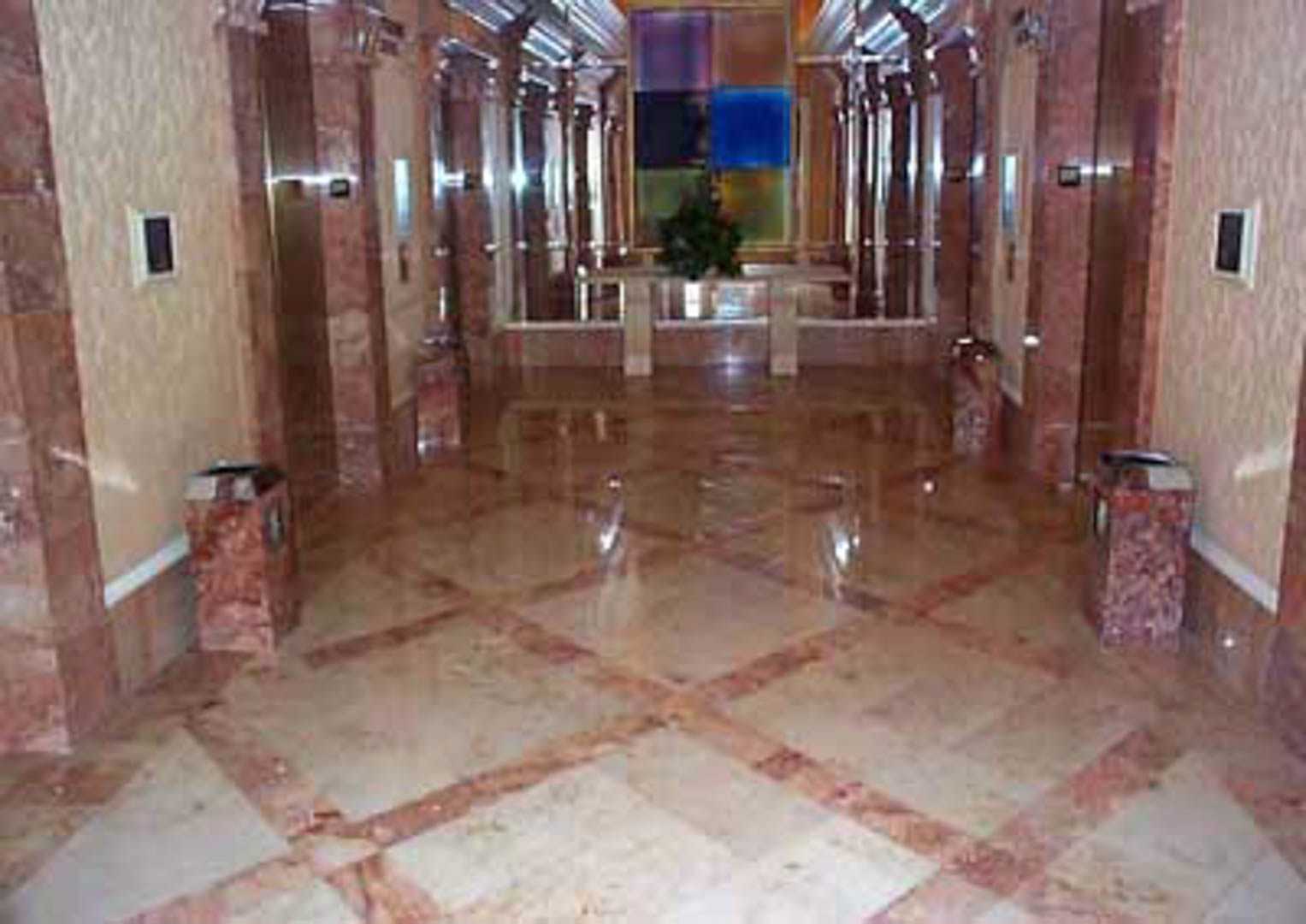 Project:  Caesars Palace Hotel   Location:  Las Vegas, Nevada   Description:  Interior Paving This photo shows fossilized limestone from Germany with accent bands of pink Italian marble.