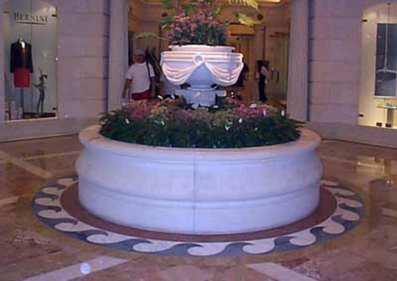 Project:  Caesars Palace Hotel   Location:  Las Vegas, Nevada   Description:  Interior Paving Shown here is Italian marble paving surrounding a precast fountain and a waterjet wave design cut in white and blue marble.