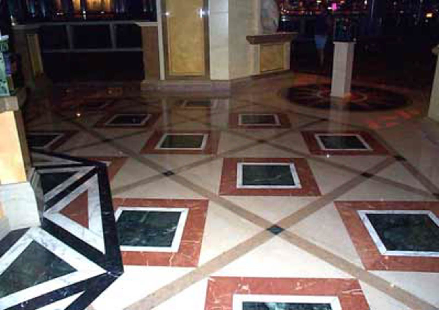 Project:  Caesars Palace Hotel   Location:  Las Vegas, Nevada   Description:  Interior Paving The entrance to the Magical Empire is a good example of pattern designs in marble. These geometric shapes were cut from Spanish beige, Italian red and Taiwanese green marble.