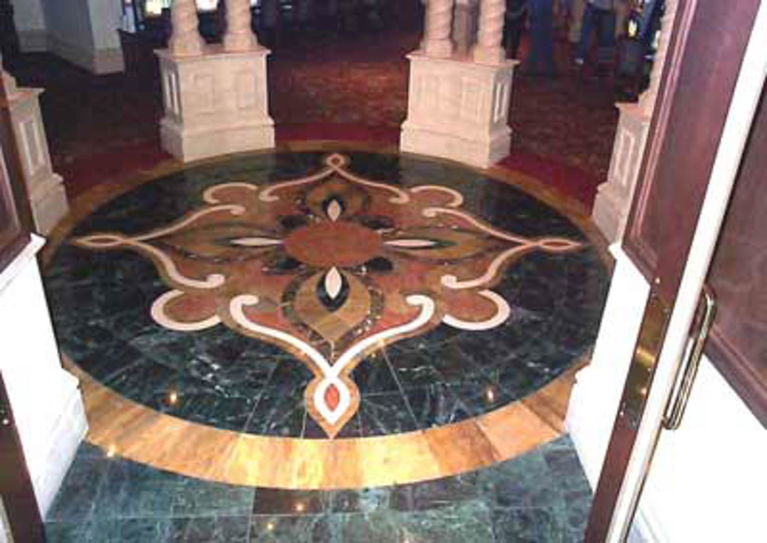 "Project:  Treasure Island Hotel   Location:  Las Vegas, Nevada   Description:  This waterjet medallion was fabricated utilizing 12"" x 12"" marble tile only. Utilizing marble tile can be cost effective and it often allows for easier transitions to carpet."