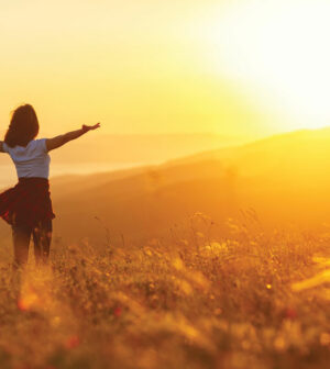 Happy-woman-standing-with-her-back-on-sunset-in-nature-iwith-open-hands.-300x336.jpg
