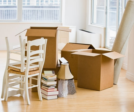 canva-moving-boxes-and-chairs-in-livingroom-MADFs90ia2U.jpg