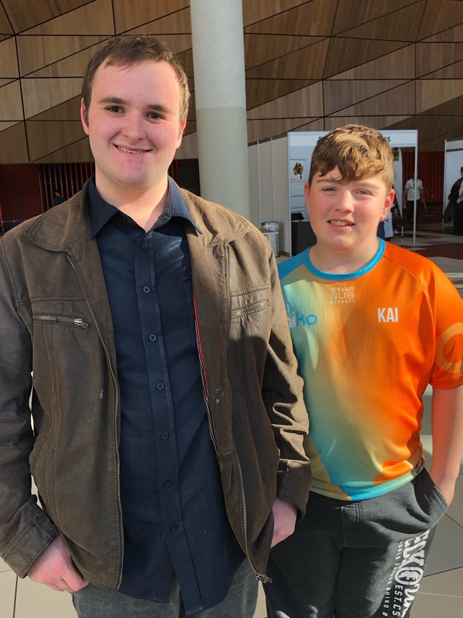 Picture Description: a photo taken at the Melbourne Convention Centre, Bryce Pace is standing next to Kai the 13 year old founder of Kaiko Fidgets.