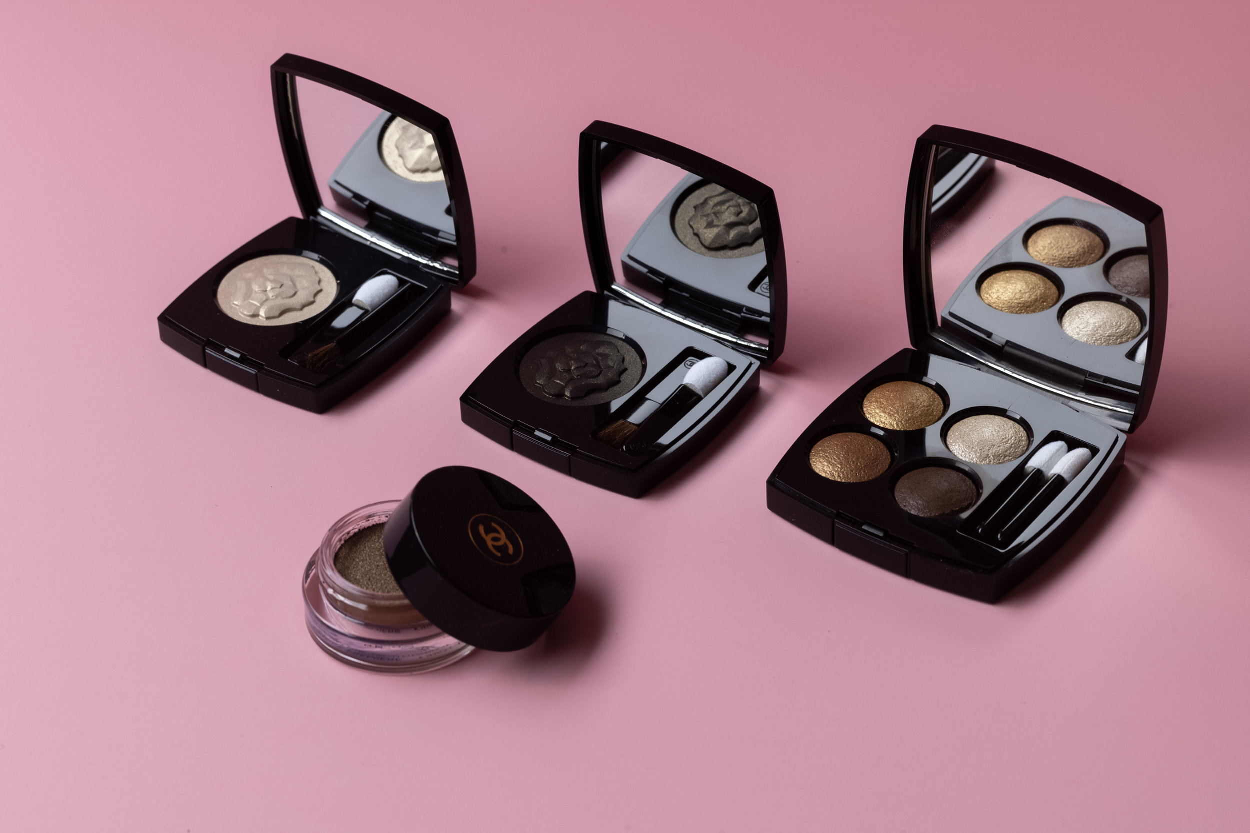 From left to right:     Ombre Première Longwear Powder Eyeshadow         in       Electrum Lame & Noir Lame,         Les 4 Ombres Multi-Effect Quadra Eyeshadow     in Condes Elegents,     Ombre Première Longwear Cream Eyeshadow     in Silver Pink