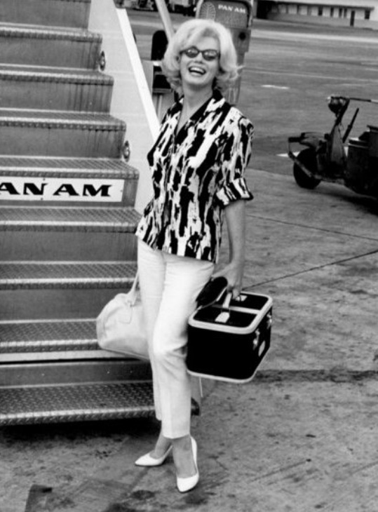 Marilyn Monroe  boarding a plane to Mexico, 1962