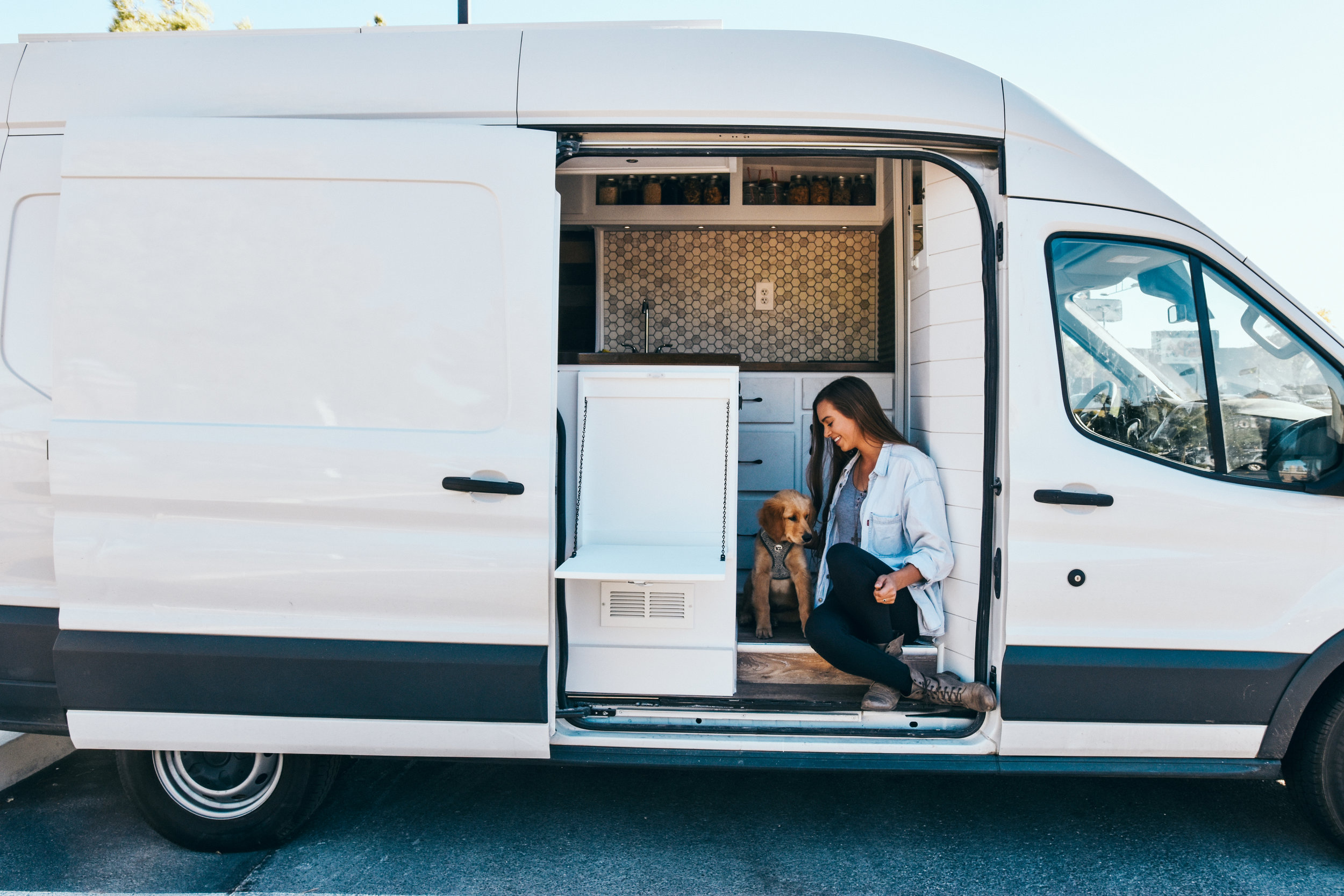 Divine On The Road - Sydney is a solo female traveler living van life and touring the USA in a white Ford Transit conversion with her pup Ella