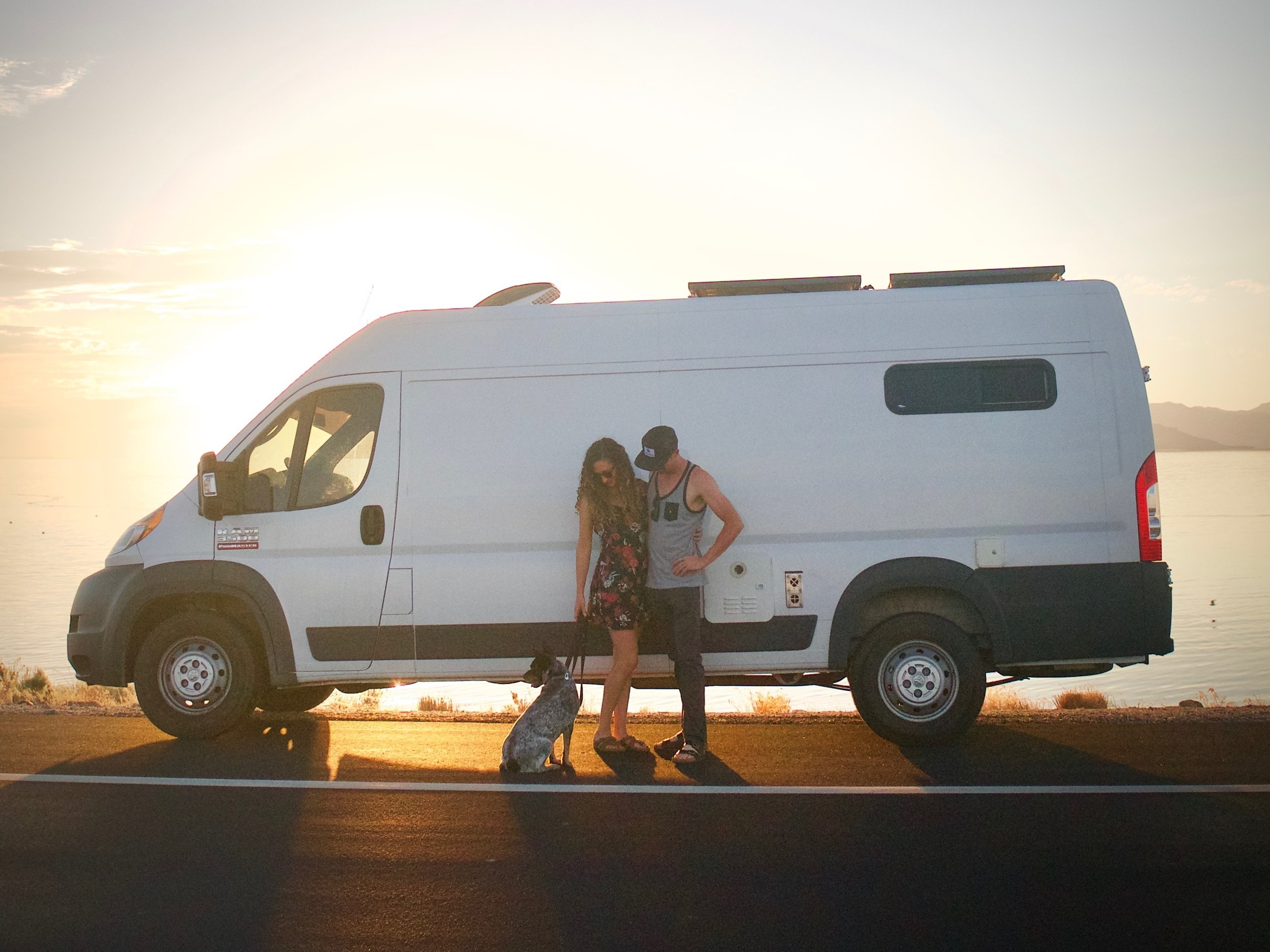 "Trent And Allie - Meet Trent and Allie, full-time Van Lifers living and sharing their journey in their self-converted 159"" extended RAM Promaster van conversion with their four-pawed friend, Frank!"