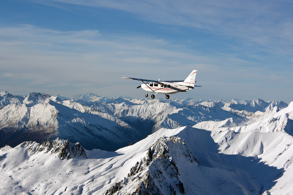 3cfd861511d749b190d8710aad861d20Airvan_over_snow_capped_mountains_copy_lg.jpg