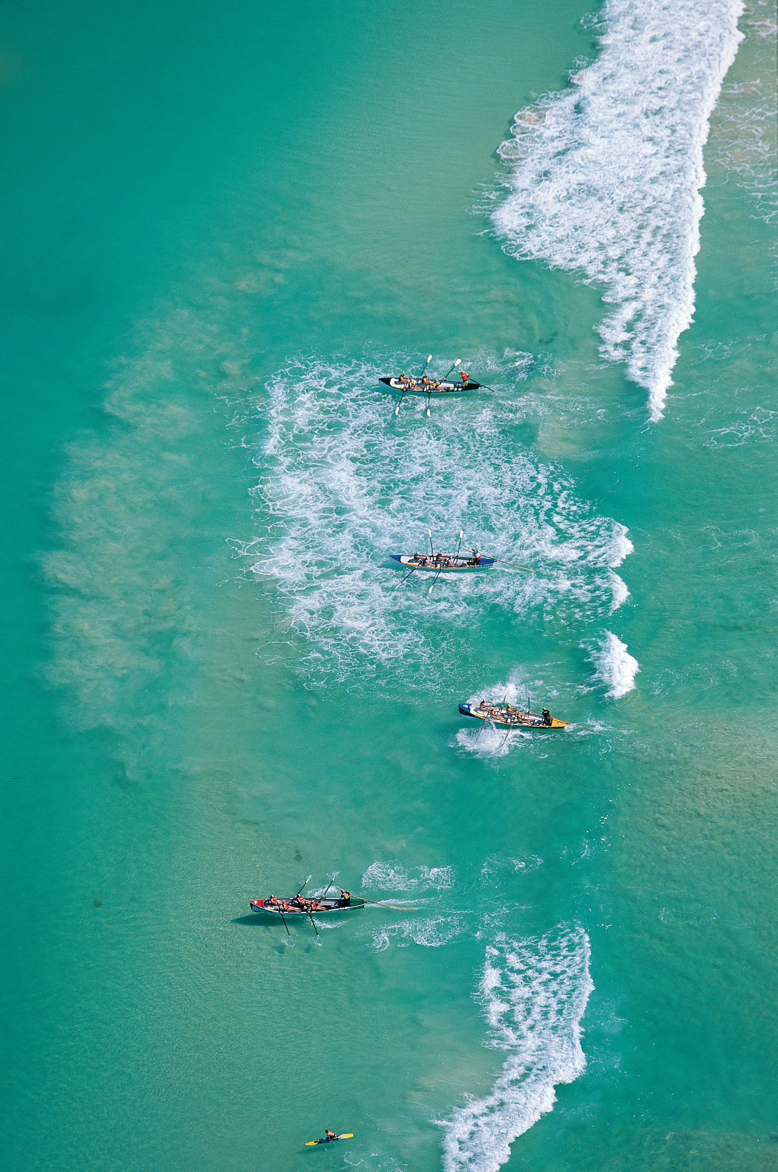 Aerial view of surf boat action on Scarborough Beach, one of Perth's popular beaches