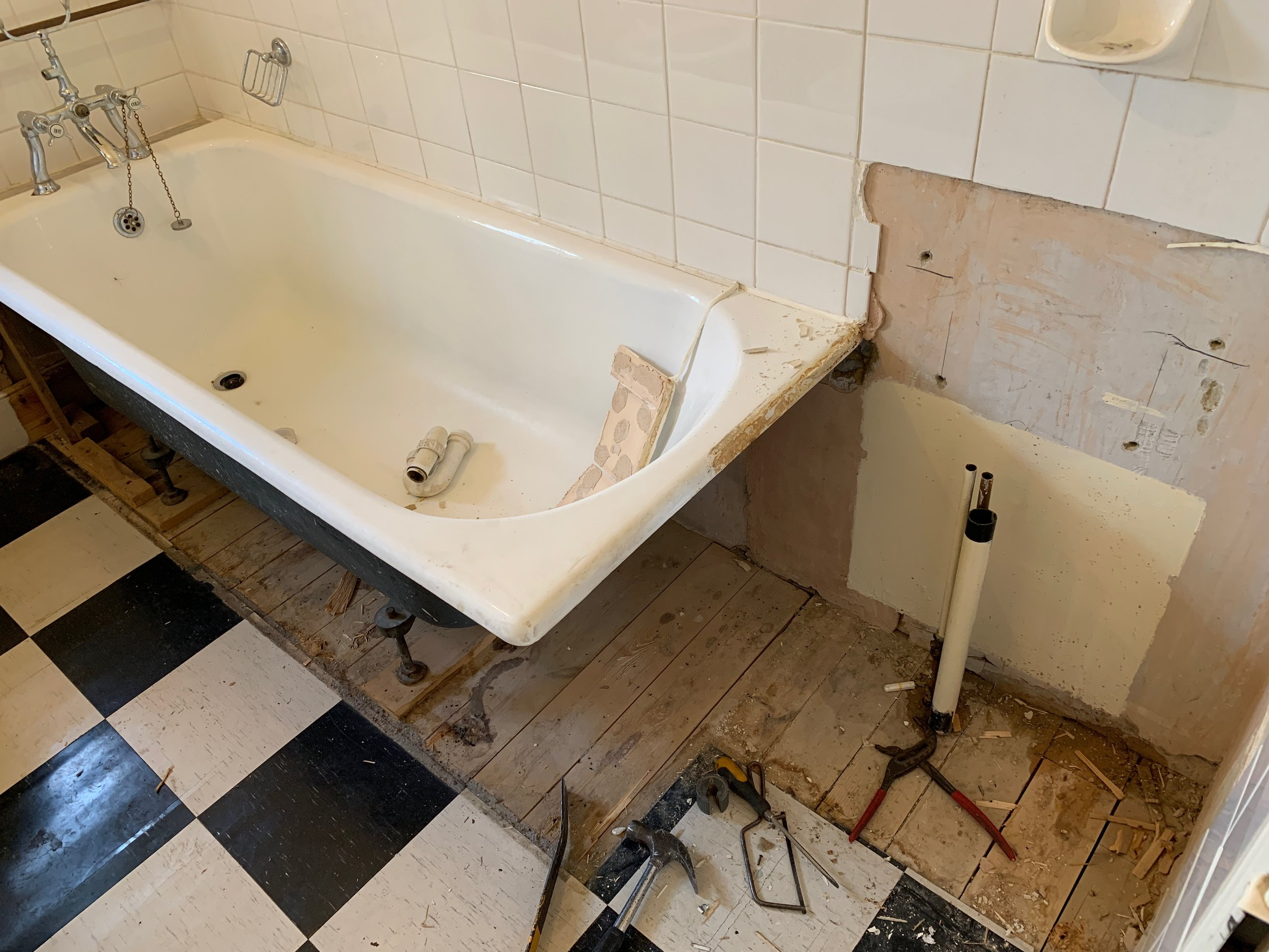The sink and vanity unit have just been removed, next-up for removal is the bath…