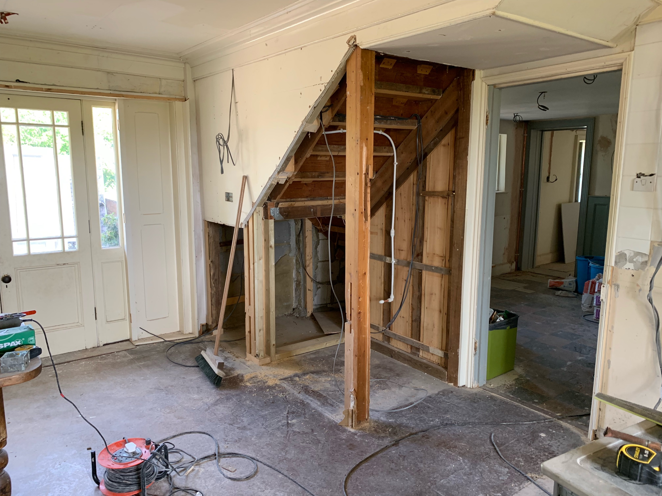 The cupboard under the stairs in the kitchen is being removed to make way for a coffee station!